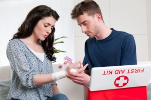 boy and girl using first aid kit